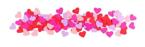 Frontière de papier colorée de coeurs de jour de valentines au-dessus de blanc Photo libre de droits
