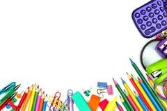 Frontière faisante le coin de fournitures scolaires sur un fond blanc photos libres de droits