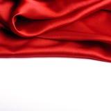 Frontière rouge de satin Photographie stock