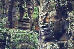 Fronti di Angkor Wat (tempiale di Bayon) Fotografia Stock