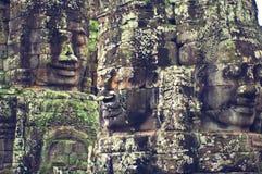 Fronti di Angkor Wat (tempiale di Bayon) Immagini Stock