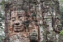 Fronti di pietra al tempio del bayon in Siem Reap, Cambogia Fotografie Stock