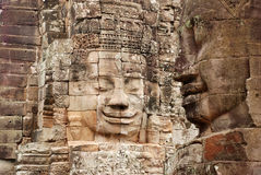 Fronti di pietra, tempio di Bayon, Angkor Wat immagine stock libera da diritti