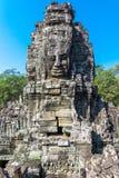 Fronti di pietra al tempio di Bayon (Prasat Bayon) Immagini Stock