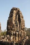 Fronti di pietra del tempio di Bayon in Angkor Wat Immagini Stock