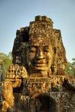 Fronti di pietra giganti al tempio di Bayon in Cambogia Immagine Stock Libera da Diritti