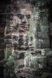 Fronti di pietra in tempio di Bayon Fotografie Stock Libere da Diritti