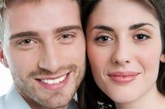 Fronti felici del primo piano delle coppie Fotografie Stock