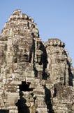 Fronti sulle torrette, tempiale di Bayon, Cambogia Fotografia Stock