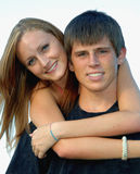 Fronti teenager felici delle coppie Immagine Stock