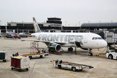 Frontier Airlines Airbus A320 plane at the gate at O'Hare International Airport in Chicago. CHICAGO, ILLINOIS - OCTOBER 25, 2015: Frontier Airlines Airbus A320 stock images