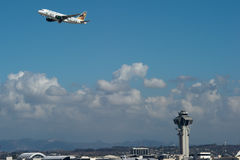 Frontier Airlines jet takes off at LAX. LOS ANGELES, CA - OCTOBER 23: A Frontier Airlines passenger jet takes off from Los Angeles International Airport (LAX) in Stock Image