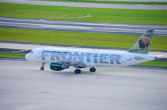 Frontier Airlines plane on the airport tarmac Royalty Free Stock Photo
