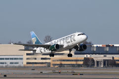 Frontier Airplane takinf off. A Frontier Airlines airplane taking off at Lambert Saint Louis International Airport in Saint Louis Missouri USA Stock Images