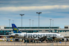 Frontier airplanes on the ground at DIA Stock Image