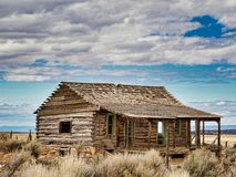 Frontier Colorado Cabin. Abandoned log cabin on Glade Park. Colorado National Monument offers spectacular views of mountains and rock formations. Beautiful in stock photos