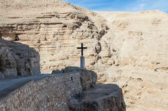 The frontier cross belonging to the monastery of St. George Hosevit Mar Jaris stands on the road leading to the monastery near M. Near Mitzpe Yeriho, Israel Stock Images