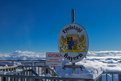 Frontier at the peak of Zugspitze, Germany. Frontier Germany Austria at the peak of Zugspitze, Germany Royalty Free Stock Photography