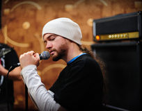 Frontman singer. Man singing on a rehearsal Stock Images