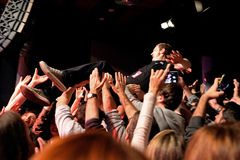 The frontman of The Subways (rock band) performs with the crowd at Bikini stage Royalty Free Stock Image