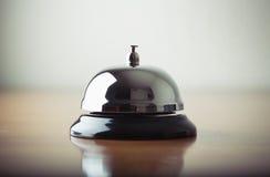 Frontowego biurka dzwon na drewno bazie Zdjęcia Stock