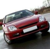 Frontowego widoku czerwieni samochód Zdjęcia Stock