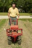 Frontowego widoku gospodarstwo rolne Używać Ogrodowego Tiller Zdjęcie Stock