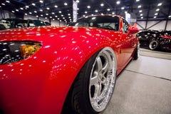 Frontowy widok czerwony samochód z sporta nastrajaniem Fotografia Royalty Free