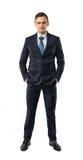 Frontowy widok wycinanka biznesmena kładzenia ręki w jego kieszeń zdjęcia stock