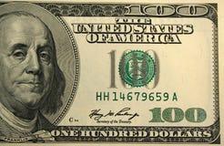 Frontseite von hundert Dollarscheinhintergrund Stockfotos