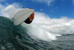 Frontside off the lip. A surfer doing a frontside turn royalty free stock image