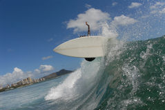 Frontside off the lip. A surfer doing a frontside turn in hawaii with diamond head in the background royalty free stock photography