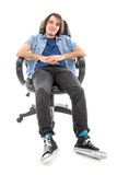Frontview of lazy man sitting stretched out in an armchair Royalty Free Stock Photography