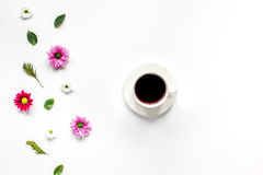 Froral flat lay with cup of coffee top view mockup royalty free stock image