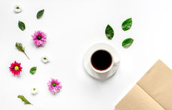 Froral flat lay with cup and notepaper top view mockup Royalty Free Stock Photo