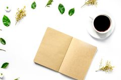 Froral flat lay with cup and notepaper top view mockup. Froral flat lay with cup of coffee and craft notepaper on white background top view mockup Stock Image