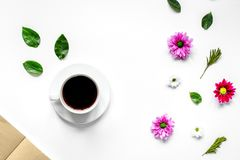 Froral flat lay with cup and notepaper top view mockup. Froral flat lay with cup of coffee and craft notepaper on white background top view mockup Royalty Free Stock Photo