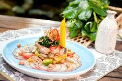 Froschfleisch mit dekorativem Hintergrund Stockfotos