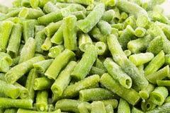 Frosen green beans. Frosen string green beans background Stock Photos