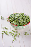 Frosen green peas Stock Photos