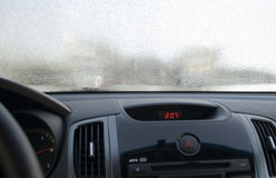 Frosen windscreen of car. Whole of rime Stock Image