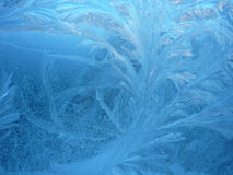 Frost. Blue christmas cold frost glass holiday ice rime snow snowdrift water window winter xmas Royalty Free Stock Images