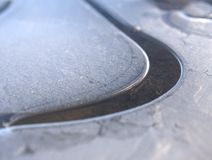 Frost background. Abstract patterns in a frozen puddle Royalty Free Stock Photo