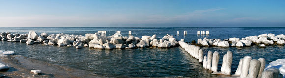 Frost on the beach. Icy stones - winter sea - frost Stock Photos