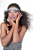 Frost Beauty. Gorgeous african american girl with frost metallic makeup Stock Image