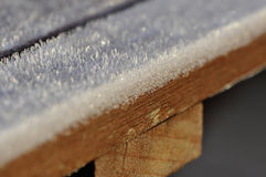 Frost on brown wood table Royalty Free Stock Images