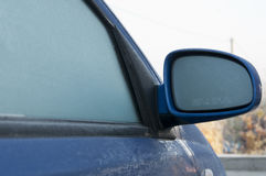 Frost on the car mirror Stock Images