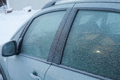 Frost on the car window. Car with pattern frost at cold winters day Royalty Free Stock Photos