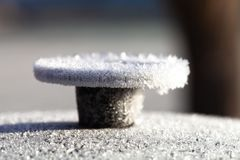 Frost on a cast iron surface. First slight frosts. Shallow depth of field. Selective focus.  royalty free stock image