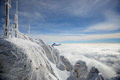 Frost covered antennas on top of the Alps Stock Images
